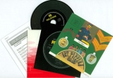 Lyric sheet, inner sleeve and CD (vinyl replica), record label, cutout kit