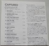 Journey - Captured, Lyric book